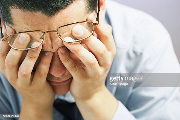 businessman with hands on eyes - depression sadness stock pictures, royalty-free photos & images