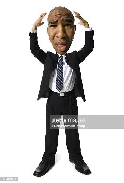 Businessman with hands up by head