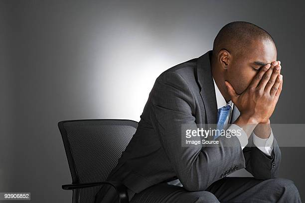 Businessman with head in hands