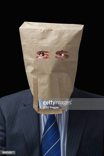 businessman with head in paper bag