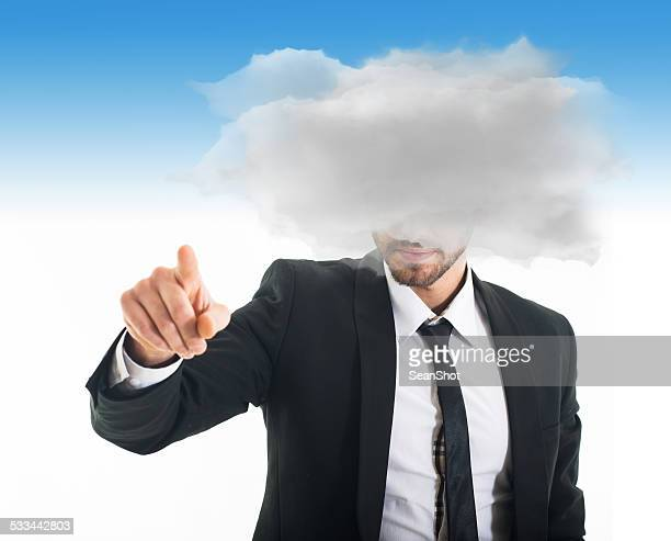 Businessman with Head in the Clouds Touching Something
