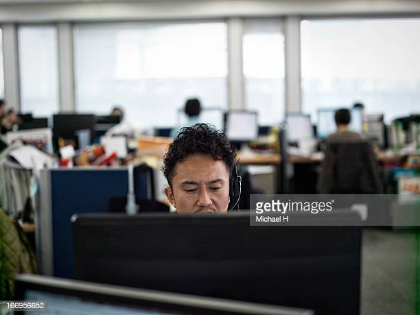 Businessman with headset in office