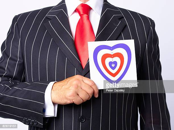 Businessman with heart target.