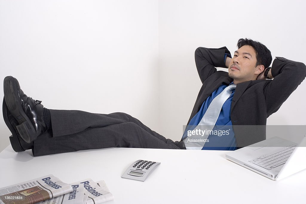 Businessman With His Arms Crossed Behind His Head Day