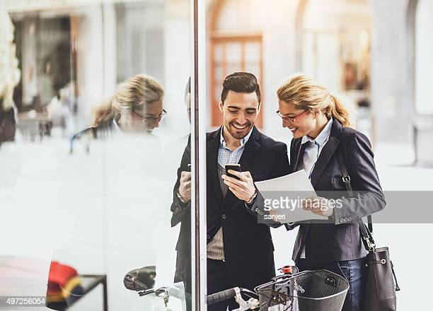 Businessman with his colleague communicating