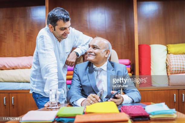 businessman with his son at their office - successor stock pictures, royalty-free photos & images