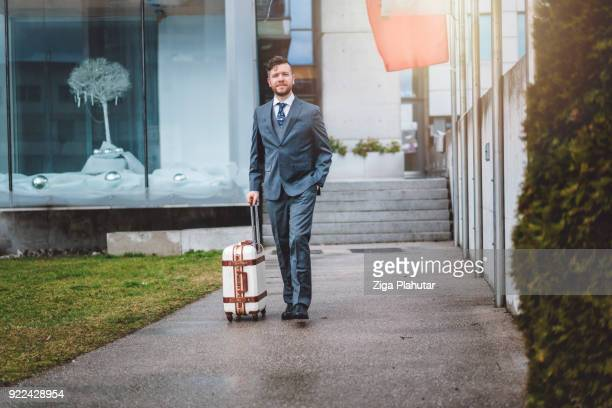 Businessman with his suitcase leaving his office