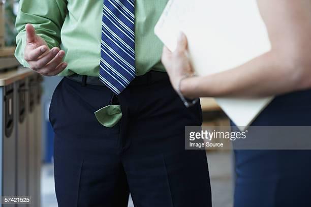 businessman with his trouser zip undone - hose stock-fotos und bilder