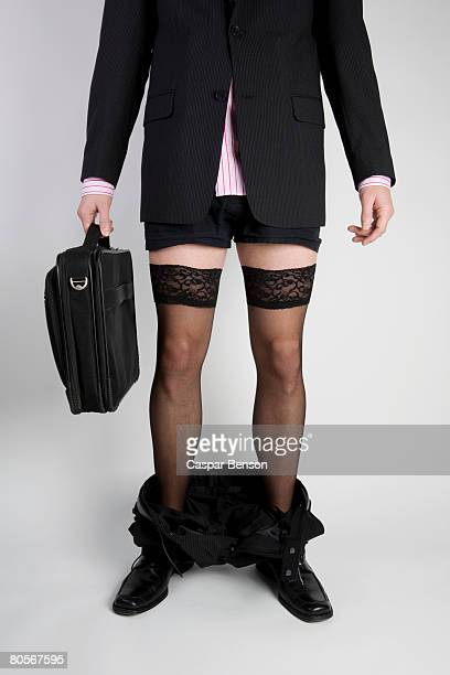 a businessman with his trousers around his ankles and wearing stockings - men wearing stockings stock photos and pictures