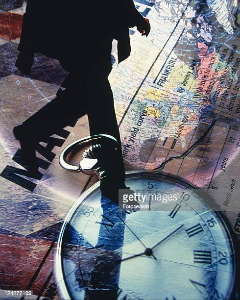 Businessman with image of clock and financial press, CG, composition