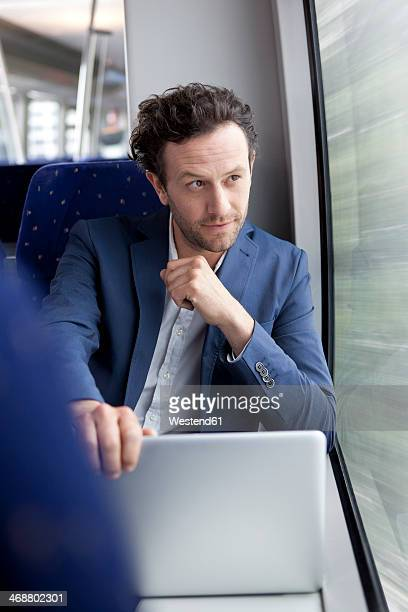 Businessman with laptop in a train