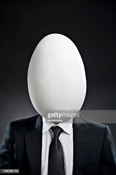 Businessman with Large Egg Head