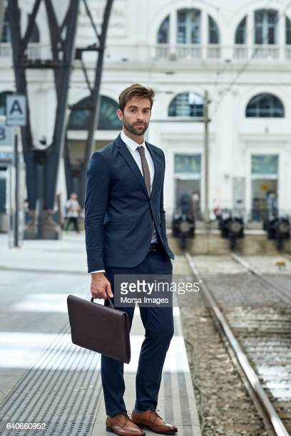 Businessman with leather briefcase at station