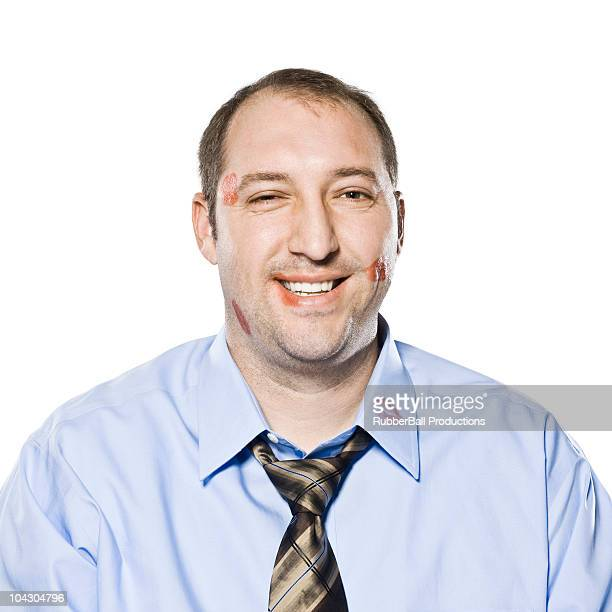 businessman with lipstick kiss marks all over his face - caught cheating stock pictures, royalty-free photos & images