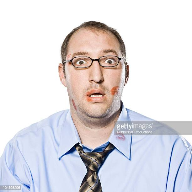 businessman with lipstick kisses on his shirt