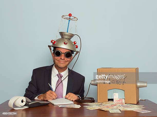 businessman with mind reading machine makes money - bringing home the bacon stock photos and pictures