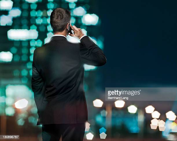 Businessman with mobile phone, rear view