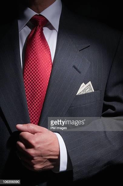 businessman with money in pocket - solapa papel fotografías e imágenes de stock