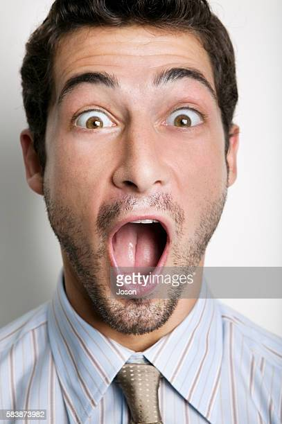 businessman with mouth open - excess stock pictures, royalty-free photos & images