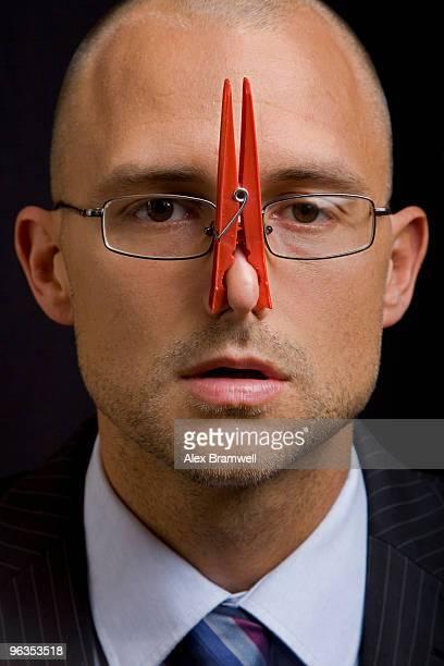 businessman with nose peg - 息を止める ストックフォトと画像
