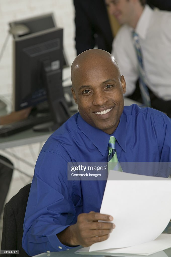 Businessman with paperwork : Stockfoto