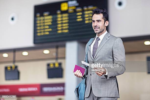 Businessman with passport and airplane ticket in the airport