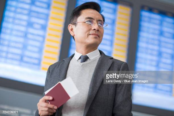 Businessman with passport and airplane ticket