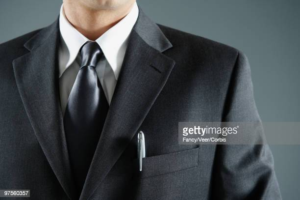 Businessman with pen in pocket