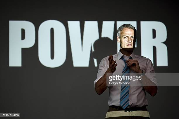 Businessman with 'power' projection