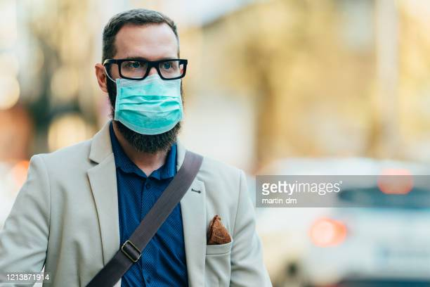 businessman with protective mask during covid-19 - businesswear stock pictures, royalty-free photos & images