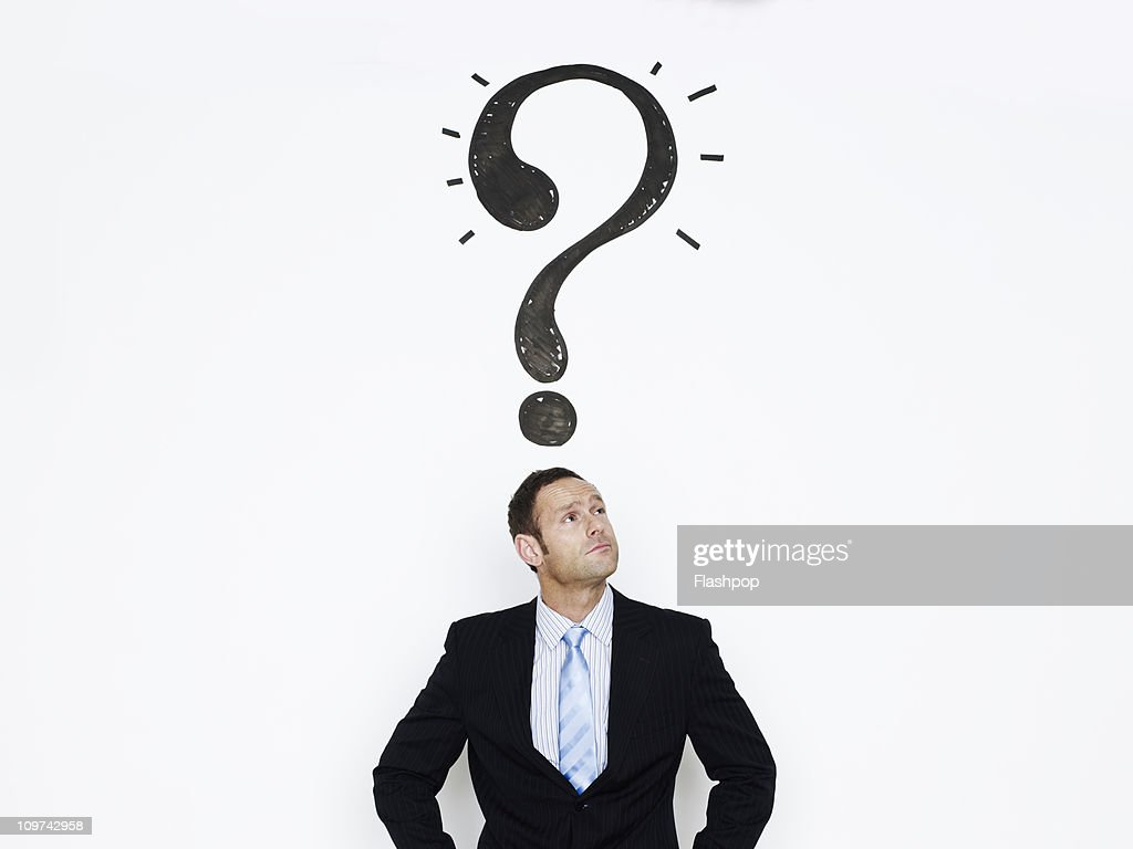 Businessman with question mark over his head : Stock Photo