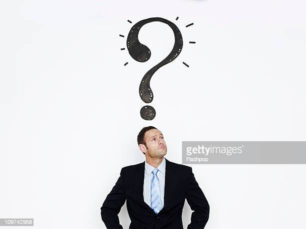 businessman with question mark over his head - 疑問 ストックフォトと画像