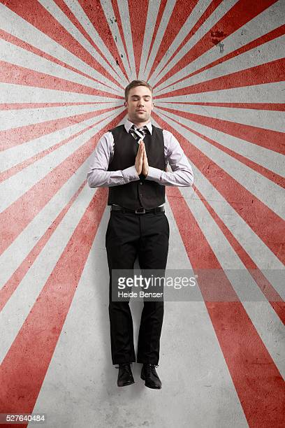 Businessman with red and white stripes in the background