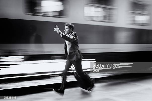 businessman  with roller case running for train on station platform - chasing stock pictures, royalty-free photos & images