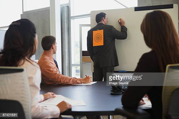 Businessman with sign on his back