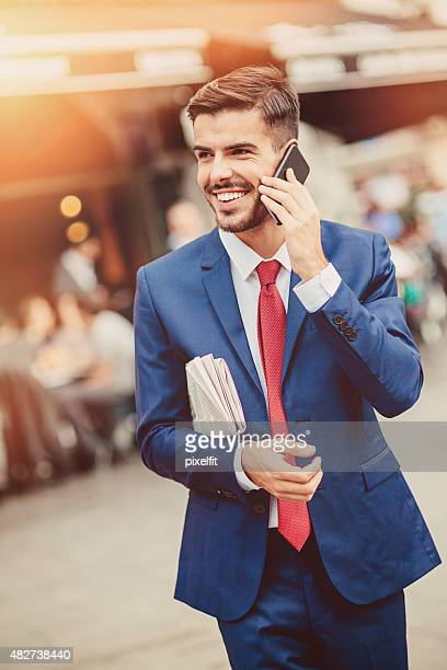 Businessman with smart phone outdoors