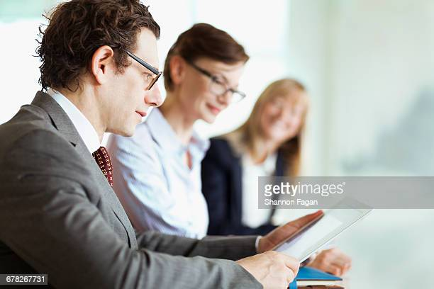 Businessman with smart tablet computer in meeting