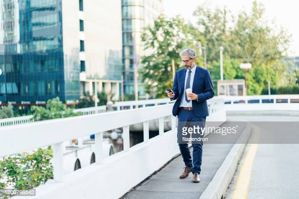 businessman with smartphone - founder stock pictures, royalty-free photos & images