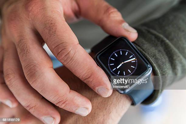 businessman with smartwatch, close-up - wrist stock pictures, royalty-free photos & images