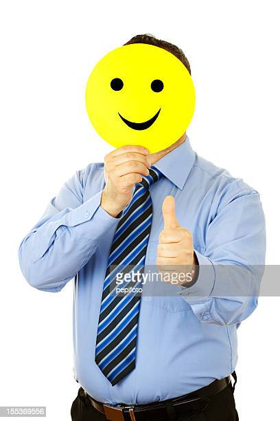 businessman with smile mask - mask cartoon characters stock pictures, royalty-free photos & images