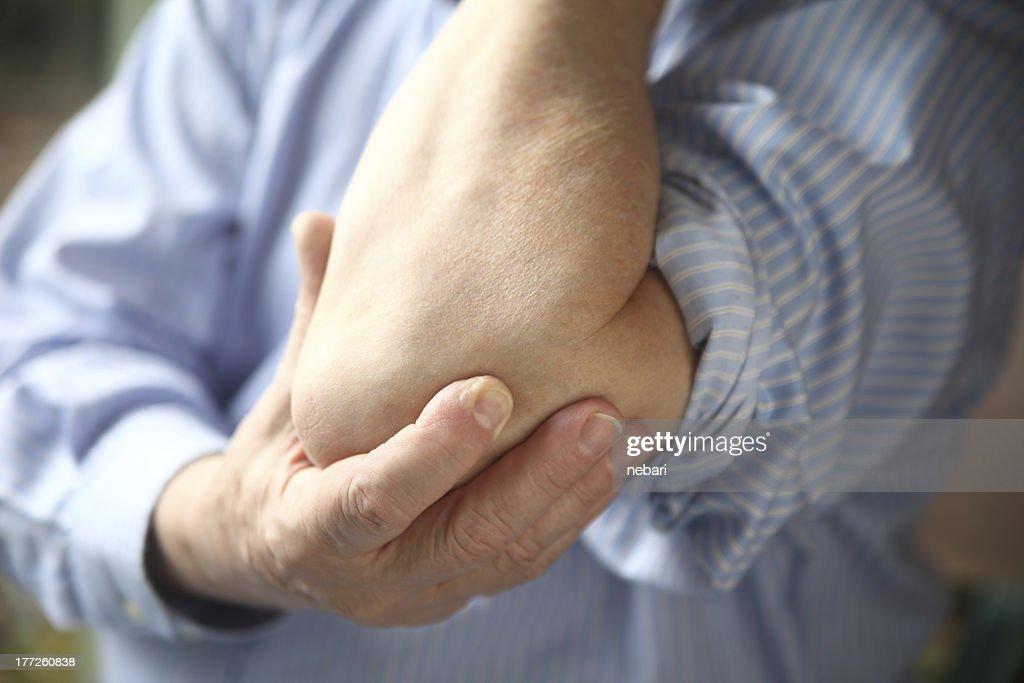 businessman with sore elbow : Stock Photo