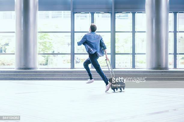 businessman with suitcase running, kyoto, japan - time management stock photos and pictures