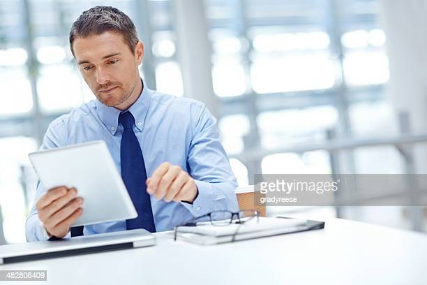 Businessman with tablet at office table