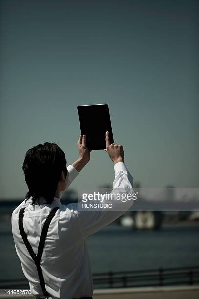 businessman with tablet computer,rear view