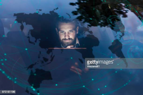 businessman with tablet in car at night surrounded by data - onderweg stockfoto's en -beelden