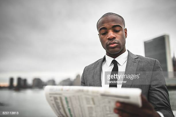 Businessman with tablet on the city