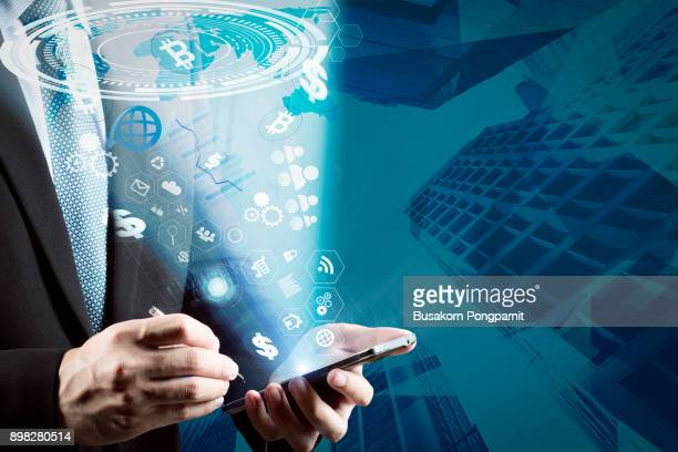 businessman with technology, internet and networking concept, select the icon on the virtual display. - marketing icons stock photos and pictures