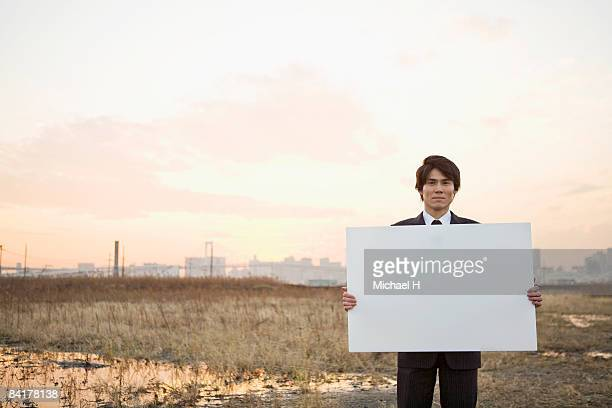 A businessman with the message board