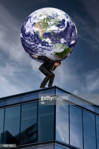 Businessman With The World On His Shoulders