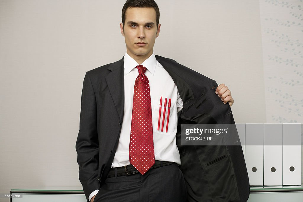 Businessman with three pens in front pocket, portrait : Photo